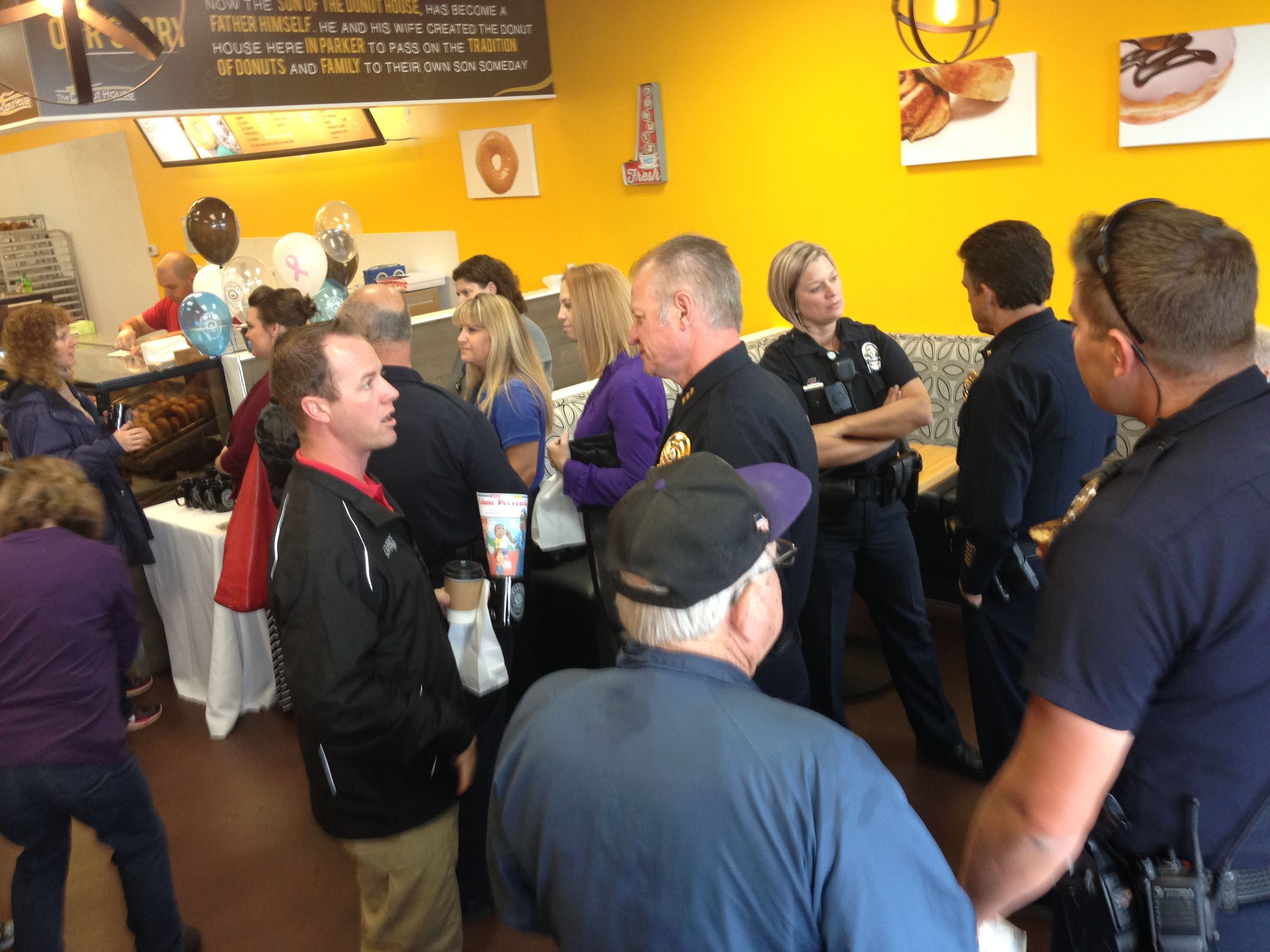 Officers talking with customers at the Donut House